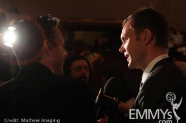 Noms ceremony host, actor Joel McHale speaks with a reporter at Goldenson Theatre.