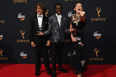 Gaten Matarazzo, Caleb McLaughlin, and Millie Bobby Brown on the red carpet at the 2016 Primetime Emmys.