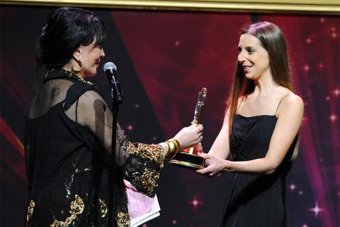 Loreena Arbus presents an award to Natalie Whalen at the 36th College Television Awards at the Skirball Cultural Center in Los Angeles, California, April 23, 2015.
