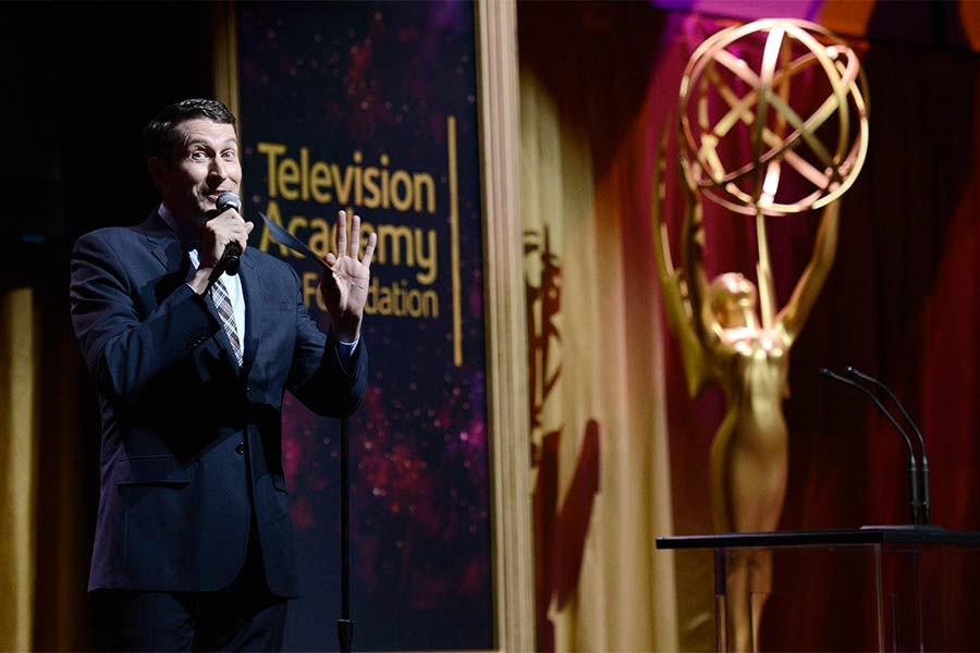 Scott Aukerman presents an award at the 36th College Television Awards at the Skirball Cultural Center in Los Angeles, California, April 23, 2015.