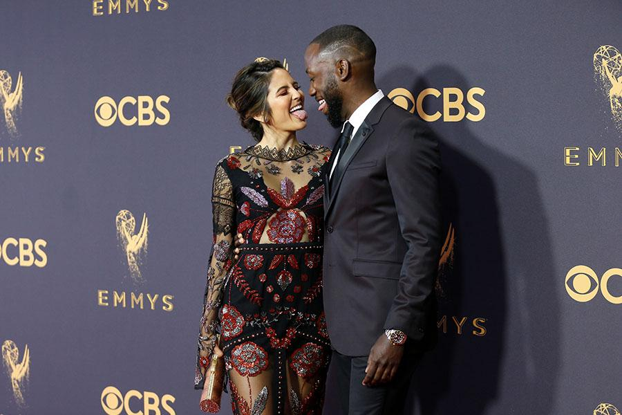 Erin Lim and Lamorne Morris on the red carpet at the 69th Primetime Emmy Awards on Sunday