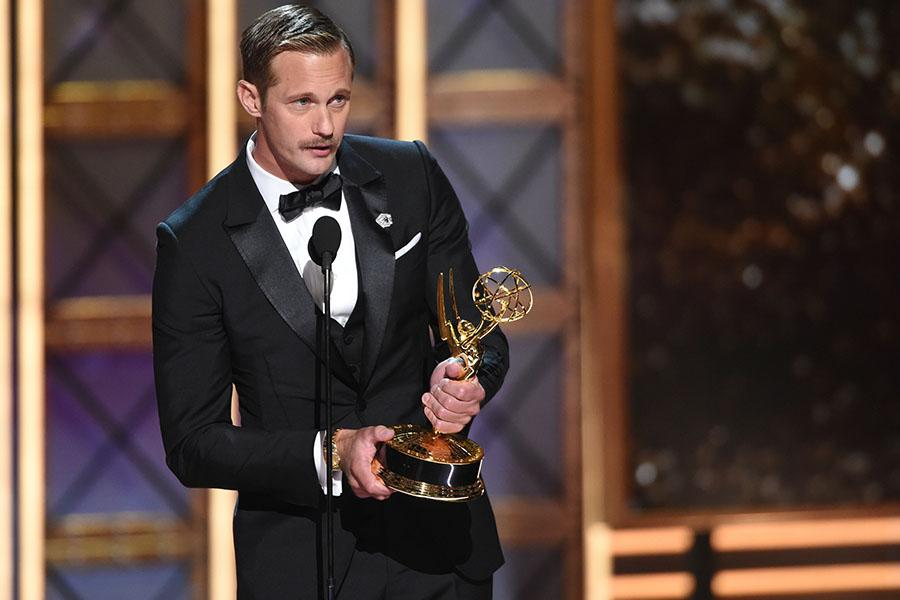 Alexander Skarsgard accepts the award at the 69th Primetime Emmy Awards