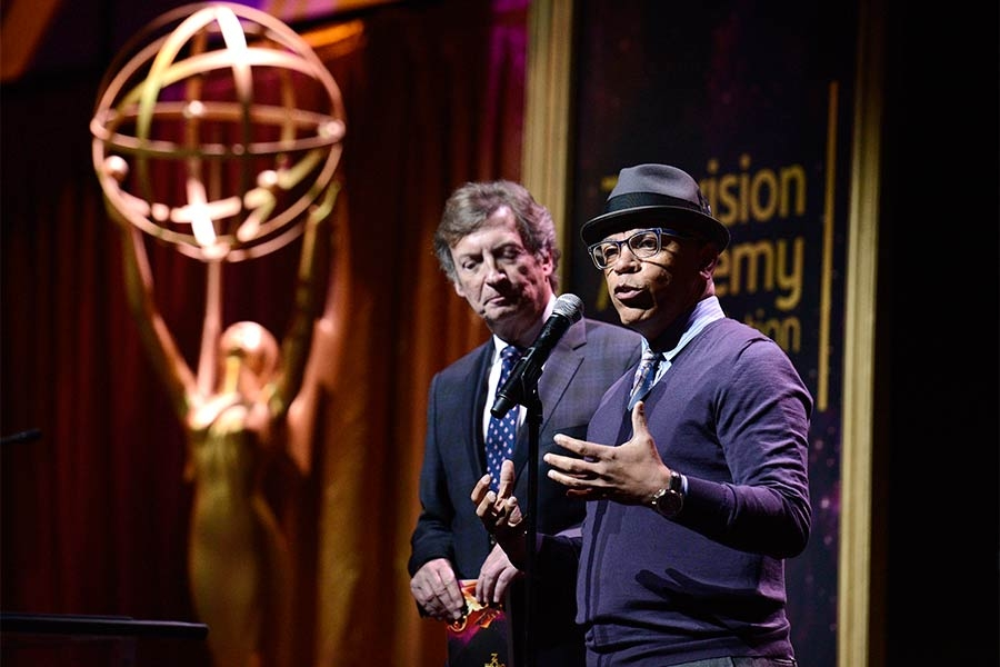 Nigel Lythgoe and Television Academy governor Rickey Minor present an award at the 36th College Television Awards at the Skirball Cultural Center in Los Angeles, California, April 23, 2015.