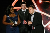 """Nickesha Johnson, Anthony Tart, and Michael Gomez of Brooklyn College accept the award in the Newscast category for """"Brooklyn College News Show 1"""" at the 35th College Television Awards"""