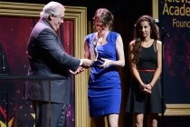 Andy Sale of Ernst and Young presents an award to Sarah Nolen at the 36th College Television Awards at the Skirball Cultural Center in Los Angeles, California, April 23, 2015.