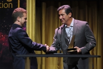 Cory Sanchez accepts an award from Benito Martinez at the 36th College Television Awards at the Skirball Cultural Center in Los Angeles, California, April 23, 2015.