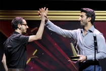 Justin Baldoni (R) congratulates Eddie Roqueta on his award at the 36th College Television Awards at the Skirball Cultural Center in Los Angeles, California, April 23, 2015.