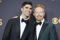 Justin Mikita and Jesse Tyler Ferguson on the red carpet at the 69th Primetime Emmy Awards