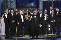 The Veep team accepts an award at the 2017 Primetime Emmys.